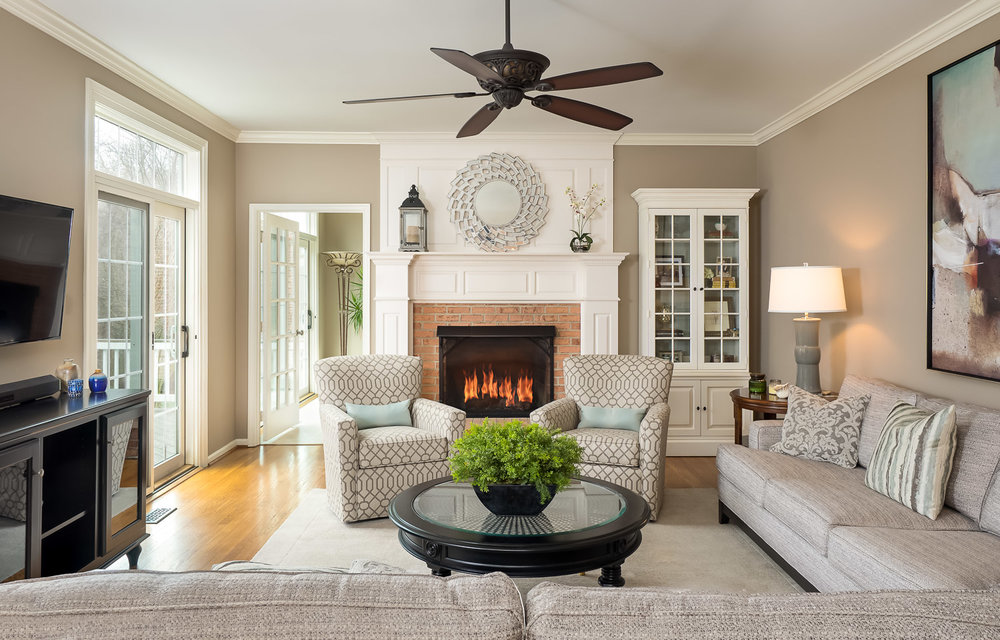 Real estate photo of spacious Ashburn home family room with fireplace shot by Robert Miller Photography.