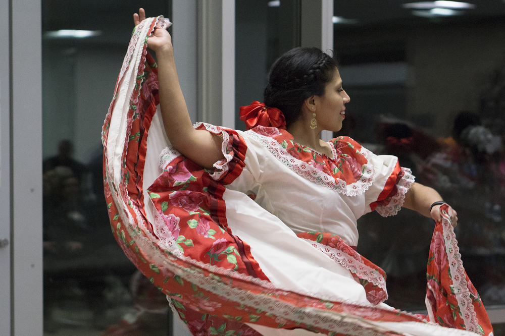 Guadalupe Mendoza with the Xochiquetzal-Tiqun Mexican Folkloric Ballet troupe performs during a Tradition Tuesday event at the Loussac Library. Xochiquetzal-Tiqun's director, Ana Gutierrez- Scholl, said the event helps showcase Anchorage's diverse heritage through music, dance and history.  Photo by Shayne Nuesca