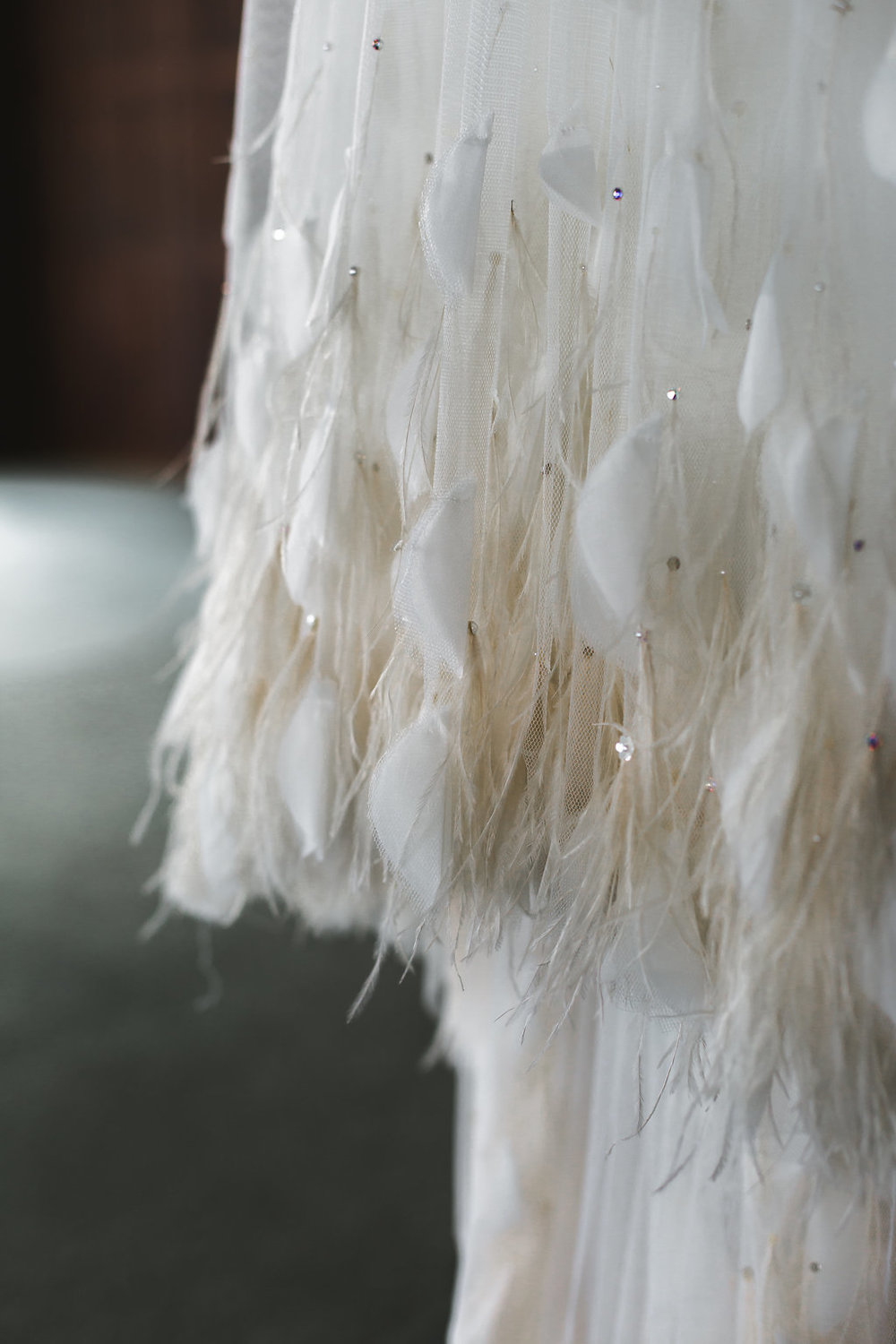 Dress # 2: Feathers! Swans showed up in every part of her wedding, including this gorgeous wedding dress she made.