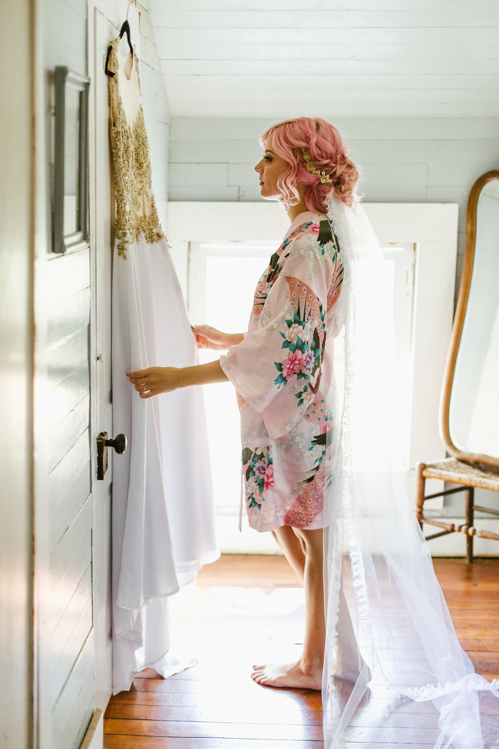 Bride with pink hair and gold wedding dress