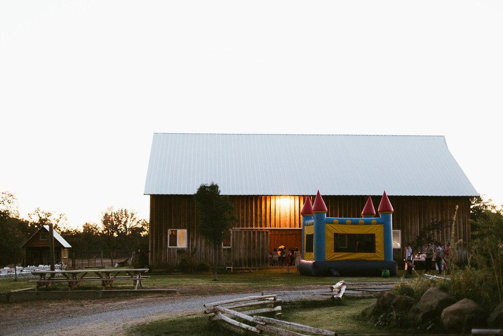 Rustic barn wedding reception, bounce house
