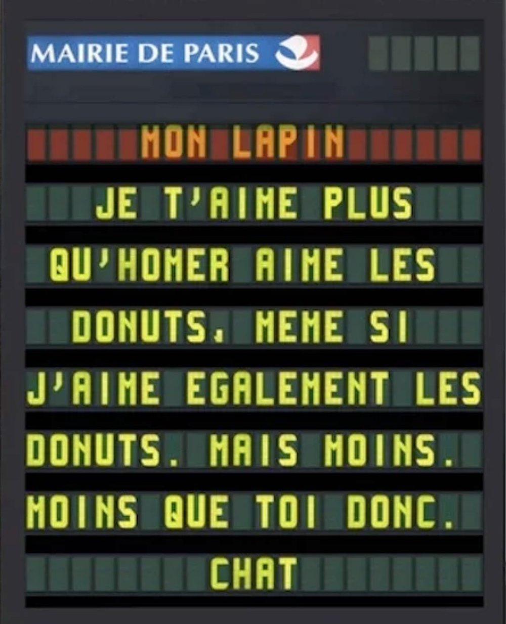 Official panel from Paris City Hall that is loosely translated: I love you more than Homer [Simpson] loves donuts. Even though I love donuts too, I love them less than you.