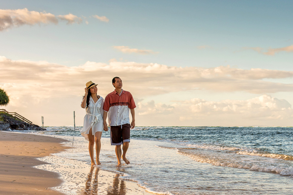 Romantic stroll on the beach in Sunshine Coast region by Fred Mc