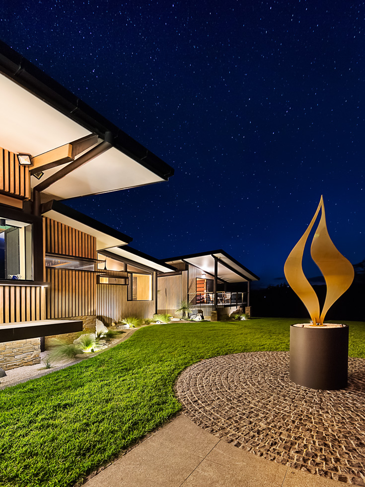 Residential architecture photography: Luxe Lodge flame statue an