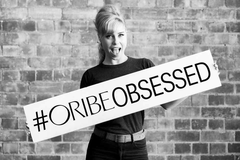 One of the two hair-styling demonstration models at the Oribe Australia Atelier with the #OribeObsessed signage available on the day for use in social media posts.