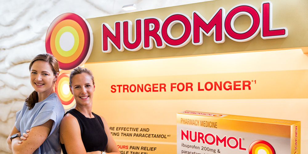 Cate and Bronte Campbell with Nuromol stand at Gold Coast confer