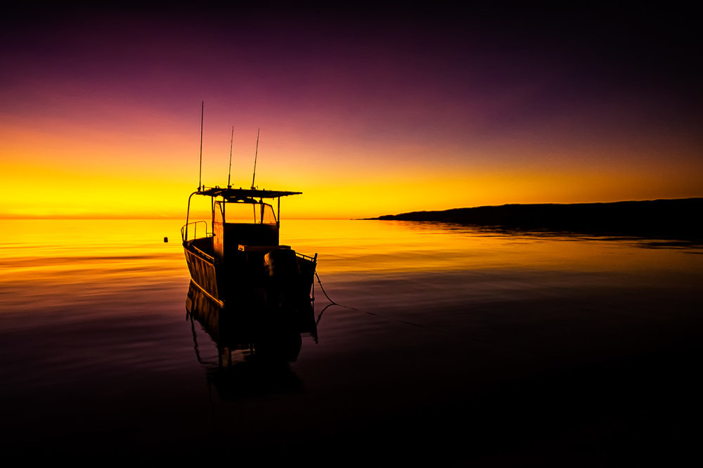 Moored fishing boat at sunrise