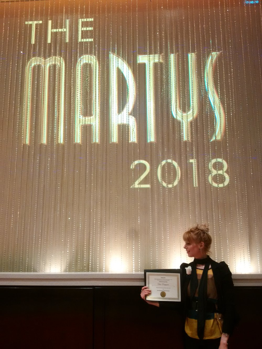The Artis was honoured to be a Finalist at the 24th annual MARTY Awards! - Publisher & Editor-in-Chief of The Artis magazine, Ivy Reiss, at the MARTY Awards ceremony on May 10th 2018, holding The Artis team's hard earned certificate!Photo: Frank Veri