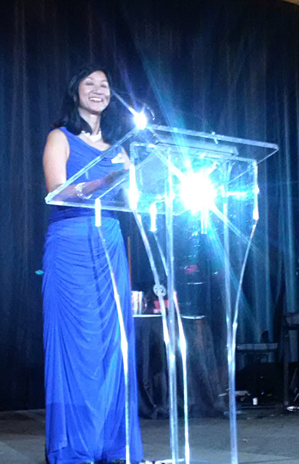 MAC President Jeannette Chau  takes the podium at the MARTY ceremony and announces the beginning of the gala!