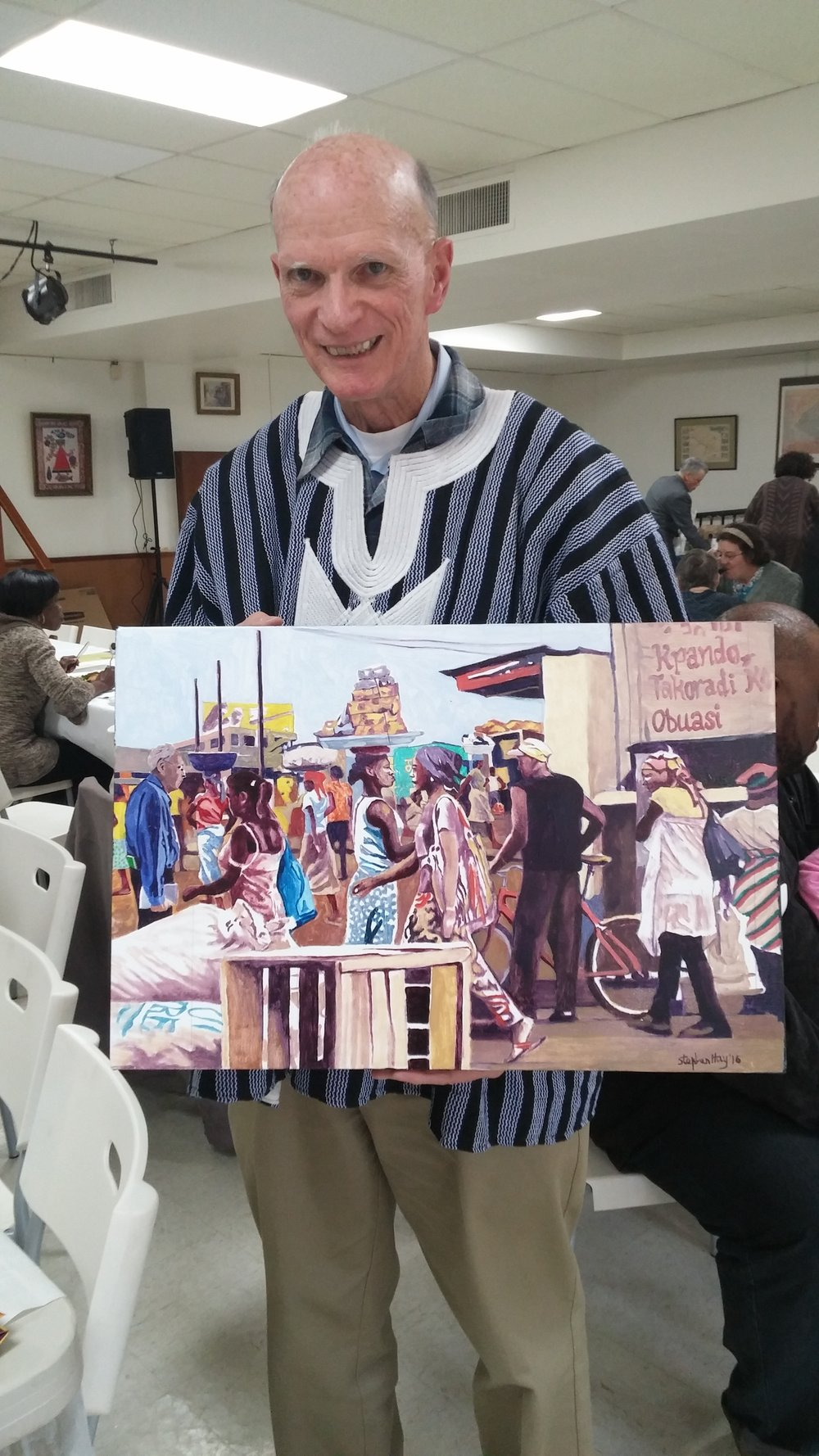 Dan O'Laughlin holding painting.jpg