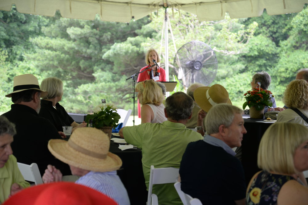 Kay Dusenbery, Director of the Frank Lloyd Wright House in Ebsworth Park, addresses guests.