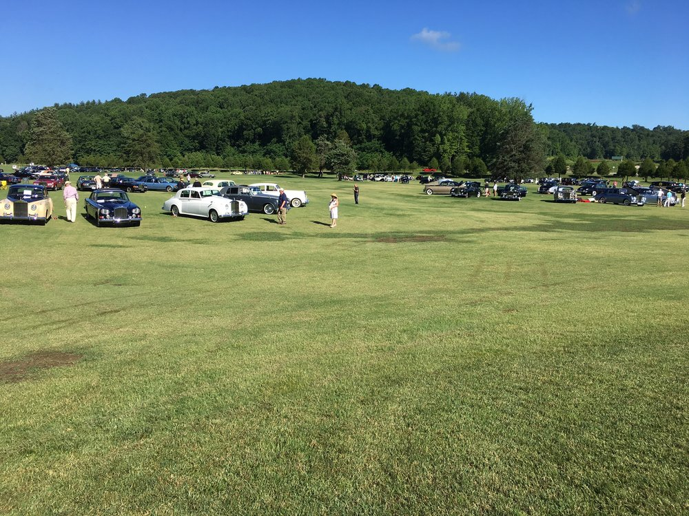The car show was held on a golf course driving range behind the French Lick Inn