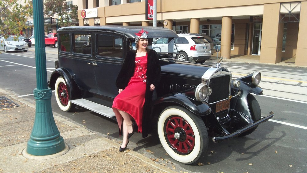 Lady in red adorns a 1928 Pierce-Arrow Sedan
