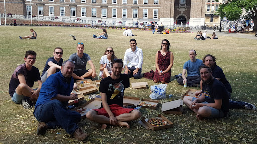 Enjoying pizza in the sun outside our offices, College Green, Bristol.
