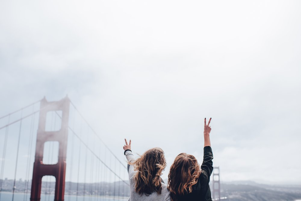 Traveling gives you and your friends a great excuse to take cheesy selfies!