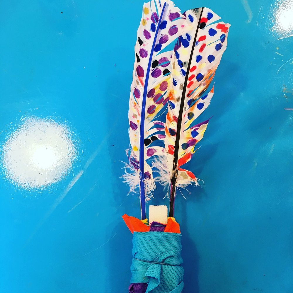 Play & Explore - Feathers - Using paint markers to decorate feathers we then used them in an assemblage sculpture, along with fabric, clout nails and foam pieces. Unusual materials can be so inspiring.
