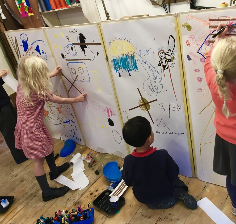 Play & Explore - It's always such fun with a smaller group to push the table away and draw on the walls! Using paint markers to draw around objects we created shapes to fill in - and then we freeformed...