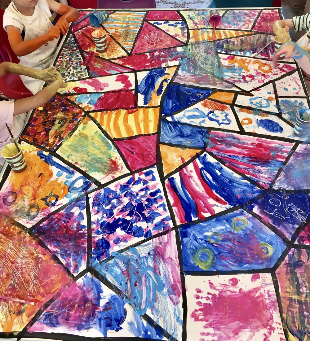 Play & Explore - Table painting - A huge collaborative art work using tempera paint on an empty background that I divided up before the class arrived. I gave instructions on who should do spots or stripes and when to change seats which made for a dynamic session - it was so much fun!