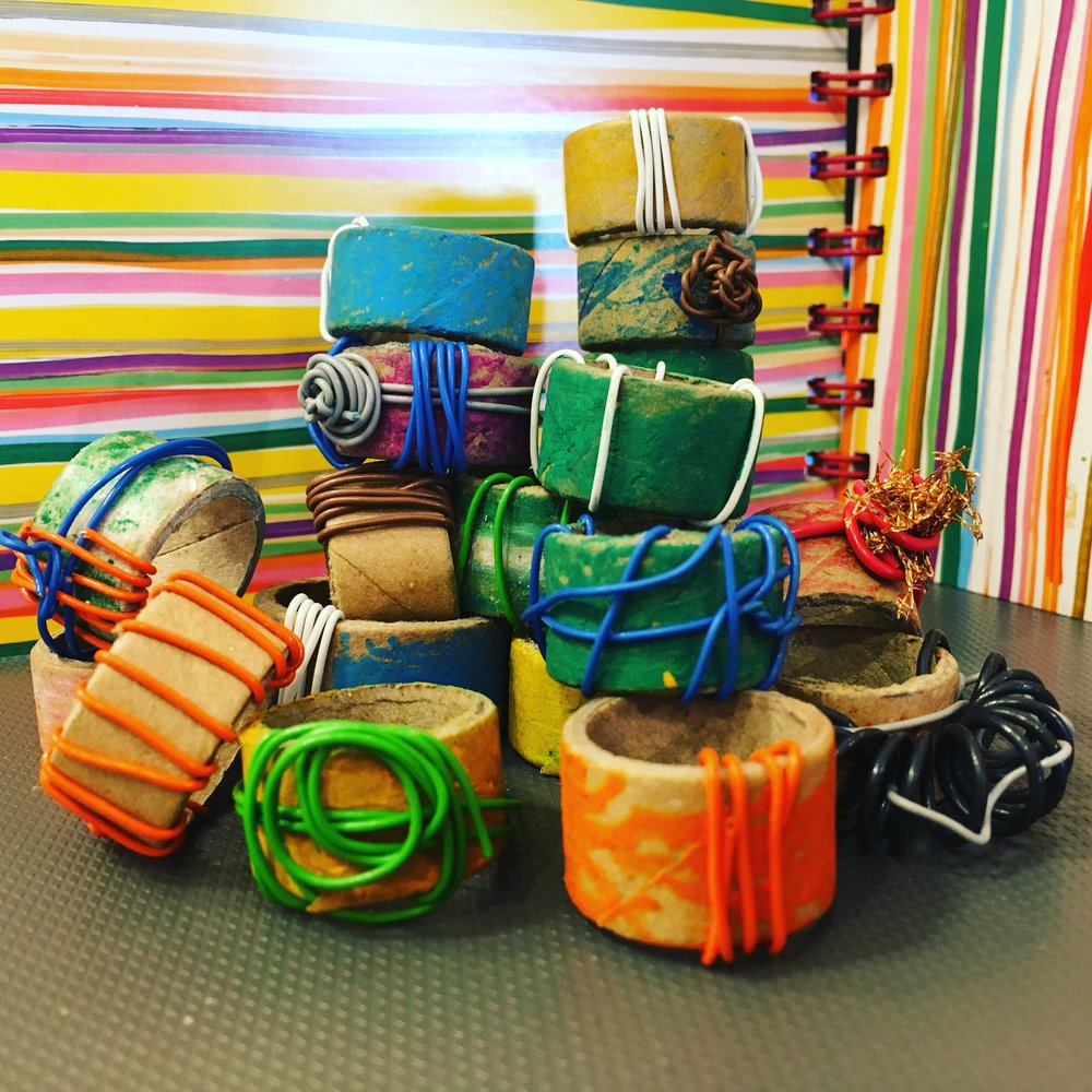 Discover & Create - Costume jewellery  - Using a variety of cardboard tubes and rolls, plus some oil pastels and wire we made a huge array of different pieces of beautiful jewellery - not recommended for wearing whilst washing up....