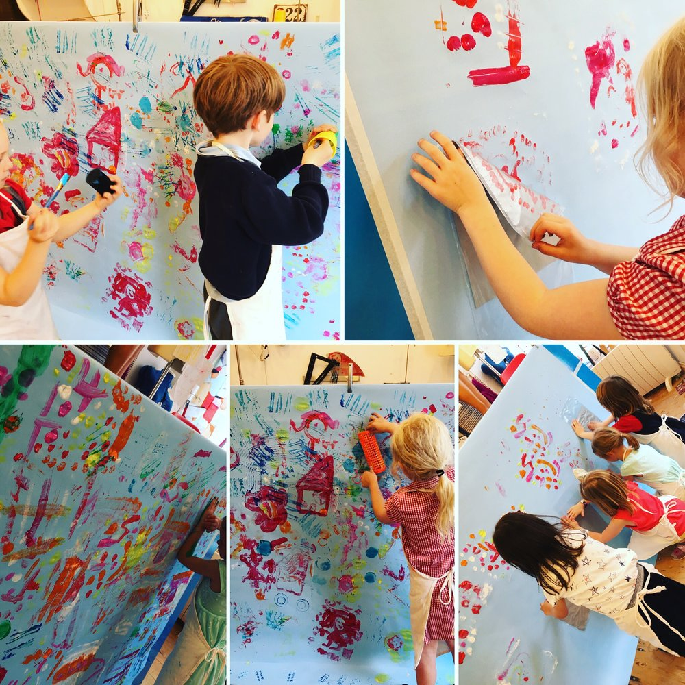 Play & Explore - Printing - We used bags, cones, rollers, sticks and anything that might leave an interesting mark in today's collaborative piece. Painting on the wall usually ends in using our hands to print, and this class was no exception! These 4 and 5 yr olds get so much pleasure from feeling the paint on their skin, and making a mess, that I sometimes think we should do it more....