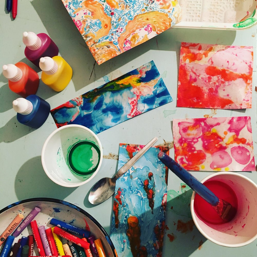 Brilliant Makers - Marbling - In the fist of our 'paper' sessions we used ink on water to create beautiful colour swirls - the workshop was covered in gorgeous colours while this lot dried!
