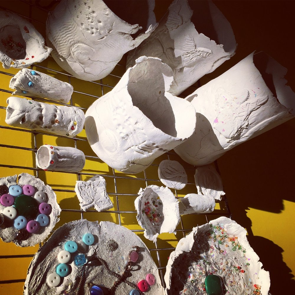 Brilliant Makers - Air Dry Clay - These artists formed their clay around moulds to make pots and bowls which they then embellished with motifs, beads and glitter. They stamped them with all sorts of utensils to make gorgeous surface designs - and we left them to dry in the sun.