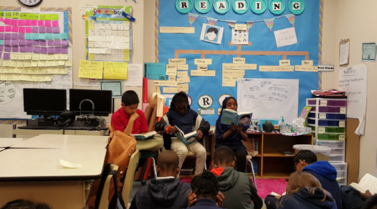 "My students reading and leading book discussions all by themselves. These are 9 and 10 year olds! The book they're reading is ""Wonder"" by RJ Palacio. 100% engagement."