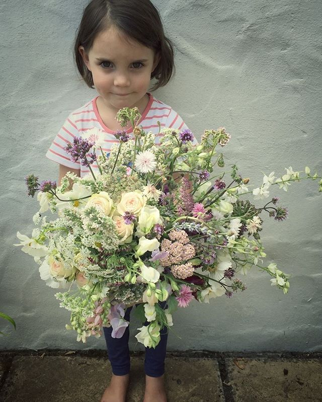 Tilda with a wild bunch of wedding snippets I had left over #gardengathered #sweetpeas #honeysuckle #wildflowers #summersup #britishblooms #britishflowers