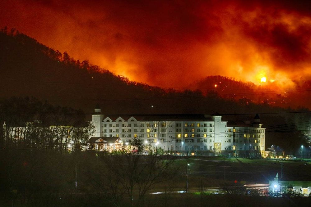 The November 2016 wildfire approached Dolly Parton's Dollywood resort. Tennessee officials reported in January the November wildfires cause more than $842 million in losses.  (Image NBC News)