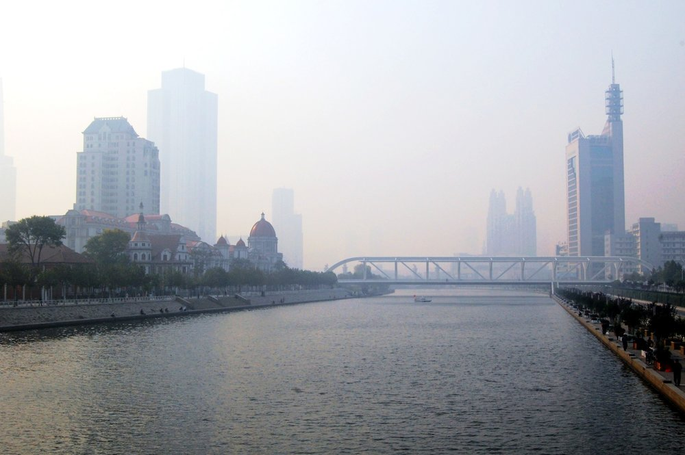 Haze envelopes buildings on the banks of the Haihe River which flows through Tianjin, China.  Photograph by  Shubert Ciencia , distributed under the  Creative Commons   Attribution 2.0 Generic  license.  Thumbnail image:   Highland Park Optimist Club wearing smog-gas masks at banquet , 1955, Public Domain
