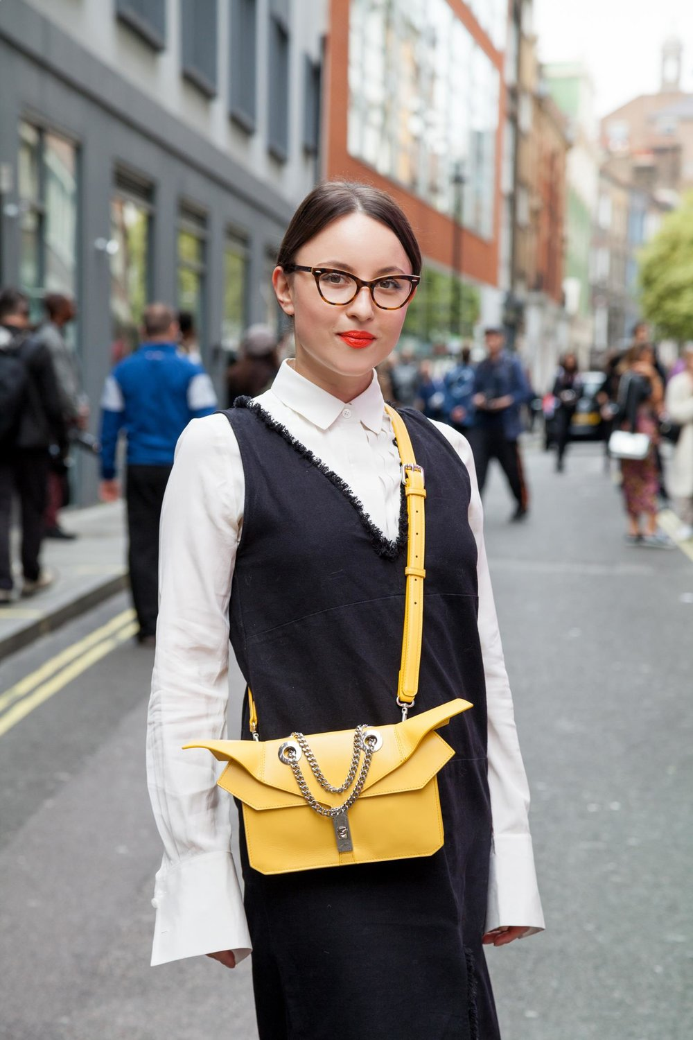 Our founder sporting the Alien Clutch in Mondrian | Here worn with strap