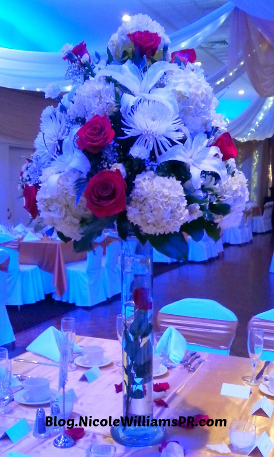High towering wedding centerpieces made with a variety of flowers and roses