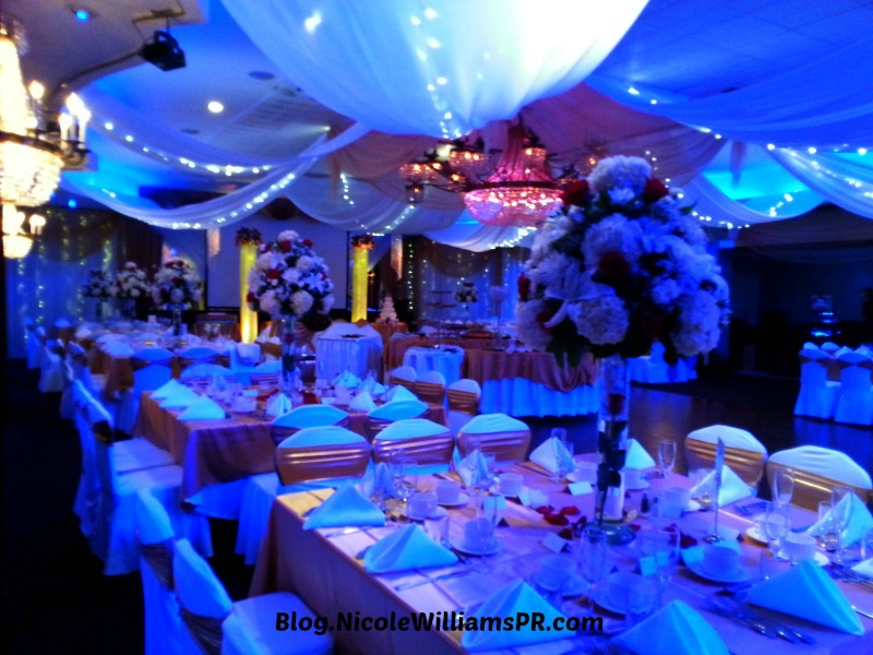 The reception room was elegantly decorated in gold, white and touches of red with magical lighting.
