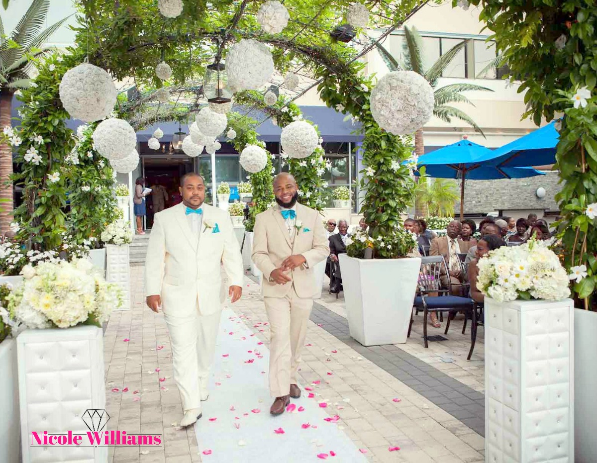 South Beach inspired wedding: Grooma nd best man walks to their spot. #realwedding