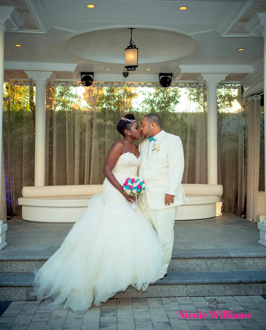 South beach inspired wedding: Bride and groom enjoy's a moment after their ceremony. #realwedding #weddingplanner