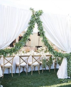 If you want go bold with this trend, add it to the entrance of your reception. It Girl Weddings has nailed it with this garland draped entryway to the outdoor reception. Follow @itgirlweddings on Instagram for more inspiration.