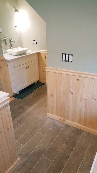 Custom wainscoting on bathroom walls