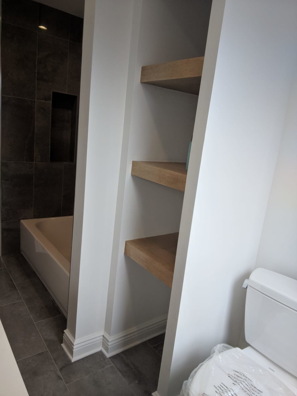 Custom floating shelves in newly renovated bathroom