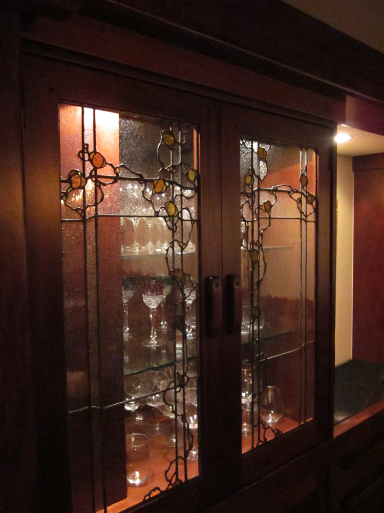 The motif for these liquor cabinet doors is used in lighting and laylights throughout this Greene & Greene inspired home. We built these with wavy german hand-blown glass.