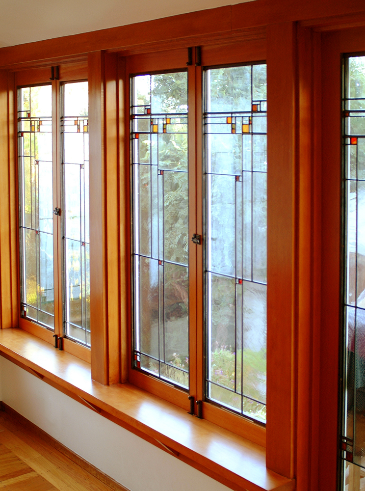The twelve panels of this wrap-around sunroom have strategically placed distorted glass to keep the neighbors from peering in.