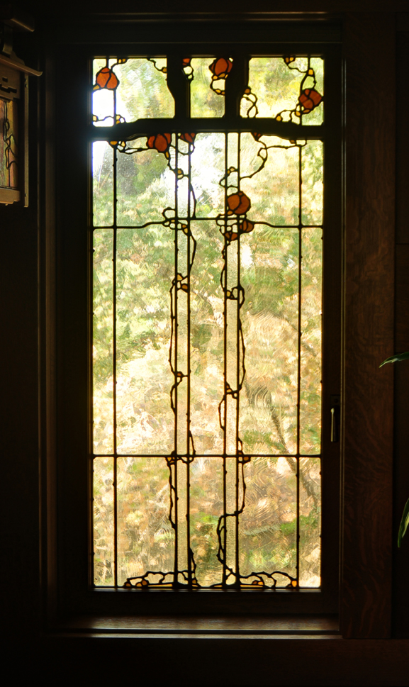 The shape and placement of the muntins became part of the leaded glass design I created for this living room casement window.