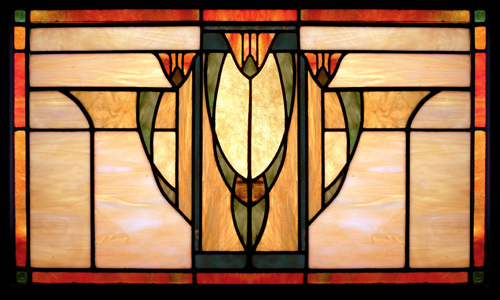The conventionalization of the tulips in this Craftsman Tulip window is inpired by window designs found in turn-of-the-century art glass catalogs.