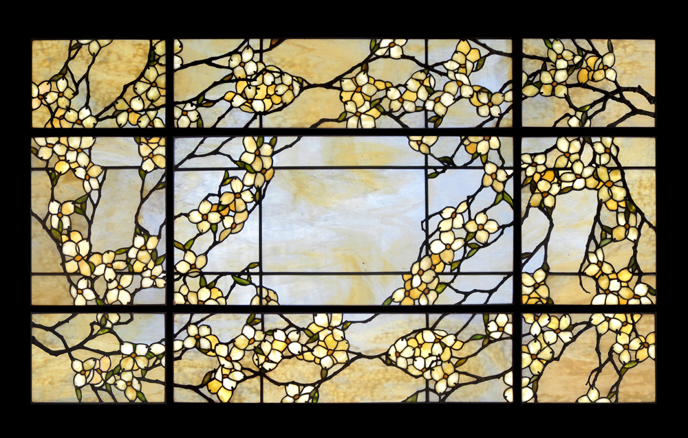 Careful attention is paid to the shading of the glass and the decorative metal work that depicts the notch at the apex of the dogwood floral bract.