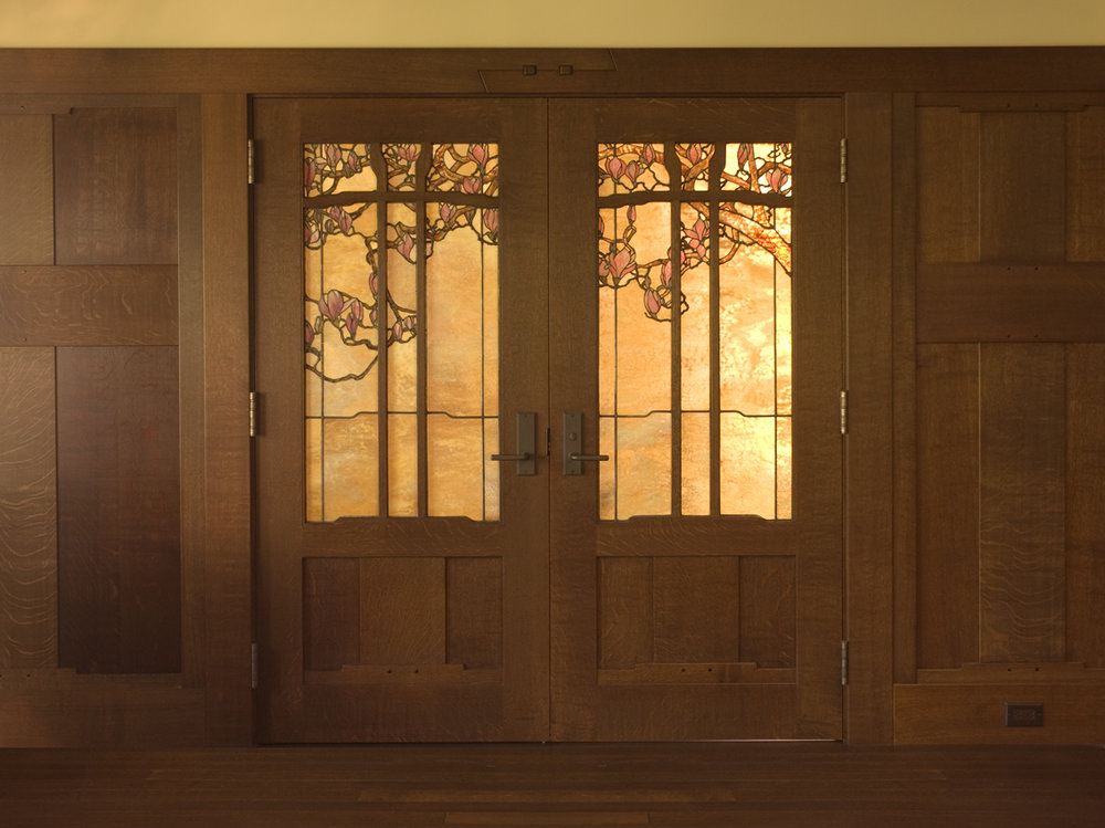 Magnolia doors to the master bedroom.