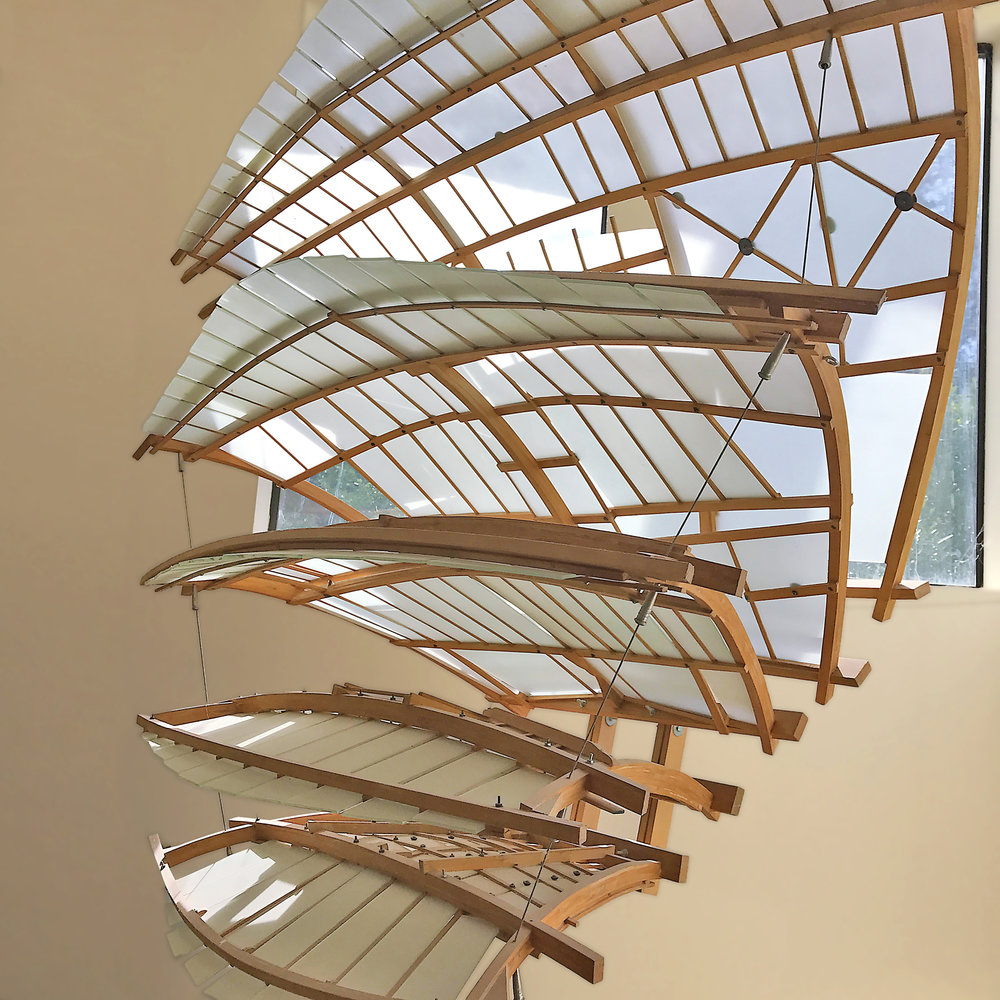 The five 'Wings' are unique frameworks that hold acid-etched glass at various angles to capture the surrounding light and transform the piece throughout the day.