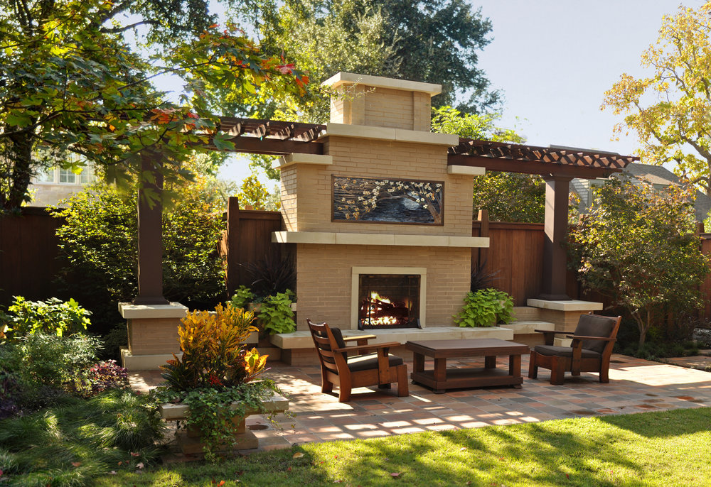 We were hired to design a Prairie School inspired outdoor fireplace and seating area for a client in Dallas, Texas.  I created a design that integrated a pergola and built-in planters with draping foliage to soften the hard-edged brick façade.