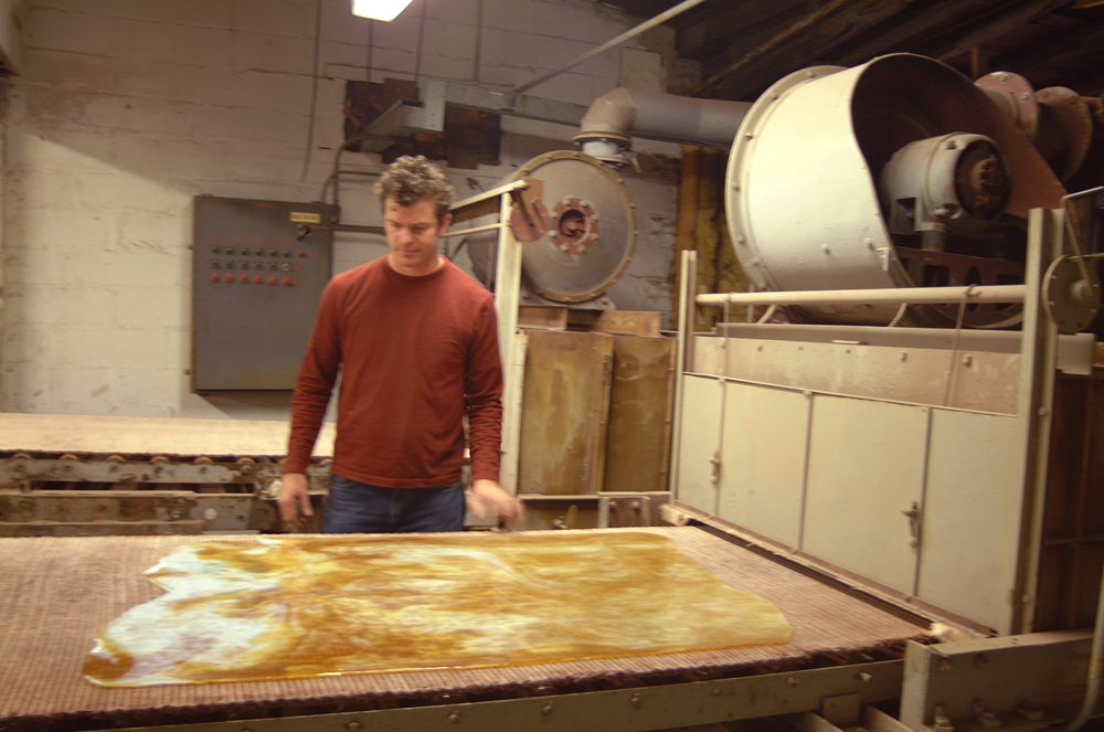 The glass is then annealed, or slowly brought down to room temperature in a long oven called a Lehr. Once the glass has traveled its length it is ready to be cut and crated for shipment. Here I'm inspecting a custom sheet at Chicago Art Glass in Wisconsin in 2003.