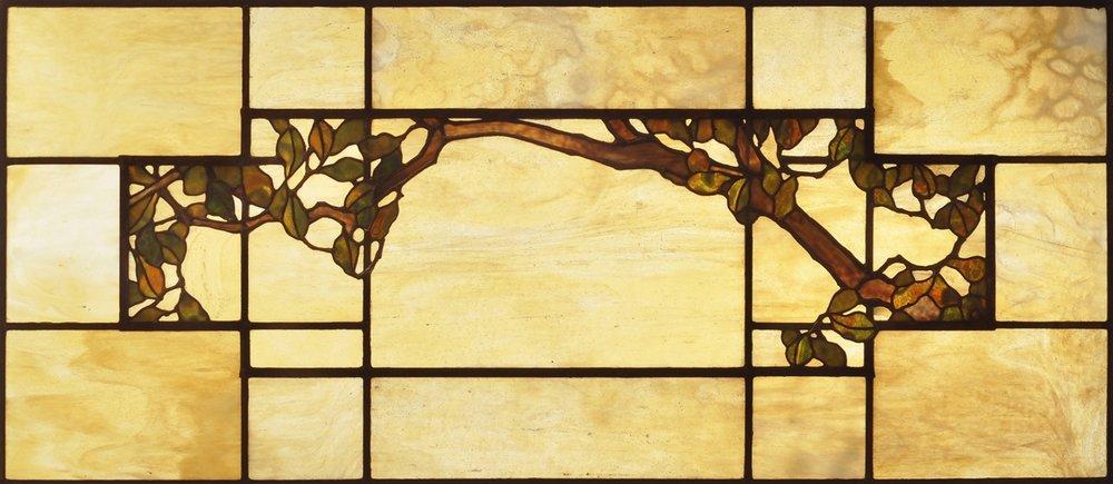 Oak branch fireplace sidelight detail.