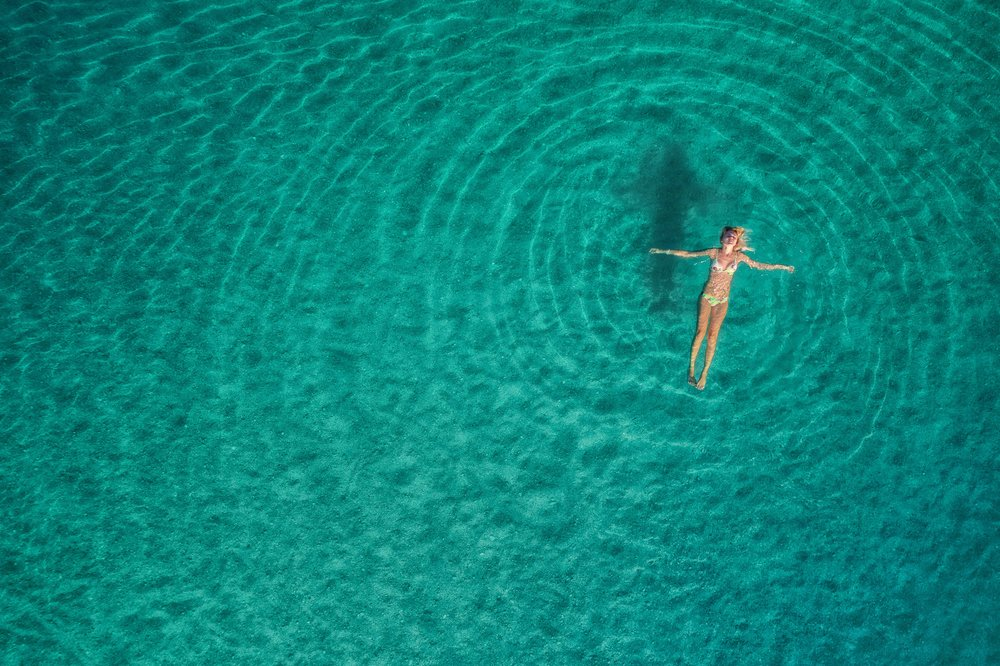 aerial-view-of-swimming-woman-in-mediterranean-PBK6ZLG.jpg