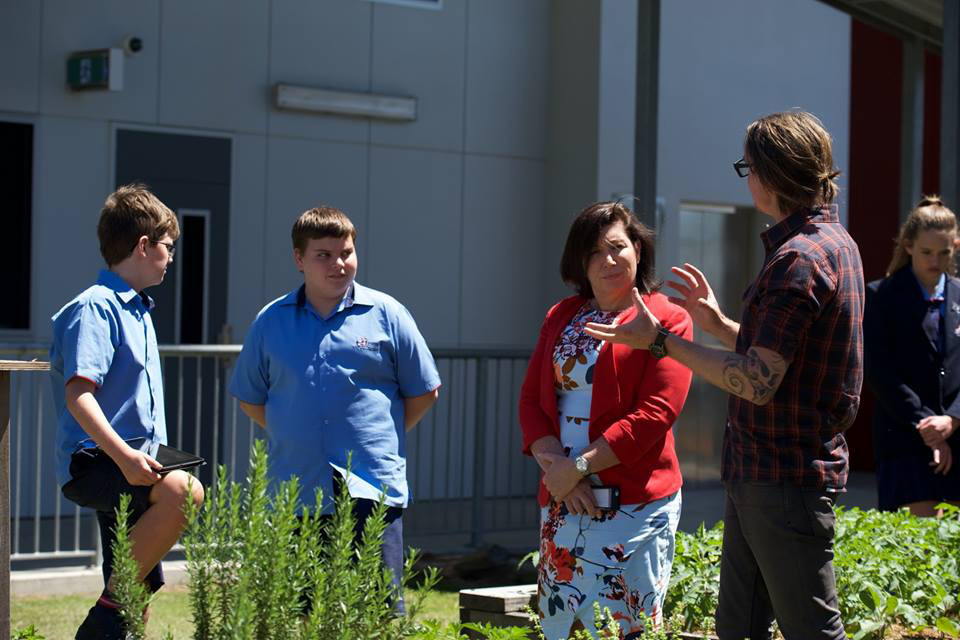 Adam discussing the Jump Start program with the Hon. Leeanne Enoch MP.